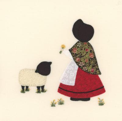 Hand stitched design of a Welsh lady with her lamb